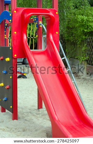 Climbing scaffold with slide in a playground / playground - stock photo