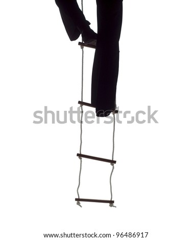 Climbing up the Rope Ladder - stock photo