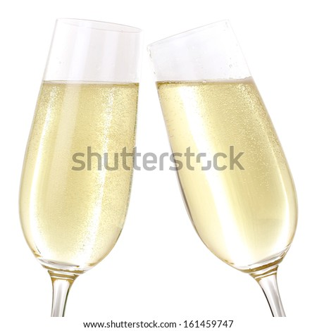 Clink glasses with two glasses filled with sparkling Champagne - stock photo