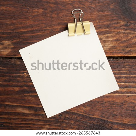 clip and note paper  on wood - stock photo