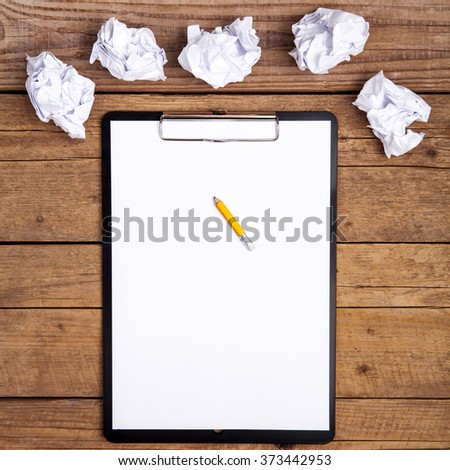 clipboard and a pencil, on old grungy wooden table. - stock photo