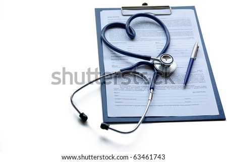 clipboard with stethoscope and pen - stock photo