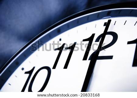 Clock about to show 12'o clock - new year, end is near, running out of time - stock photo