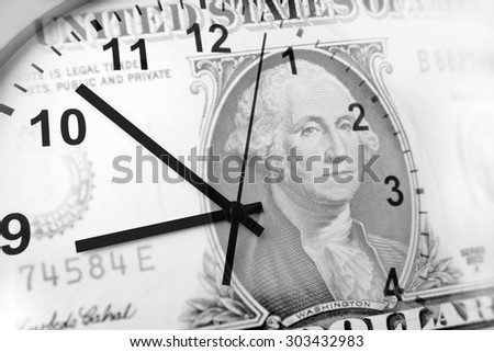 Clock and American banknote. Time is money  - stock photo