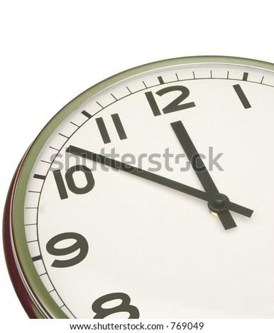 clock at five minutes to twelve - stock photo