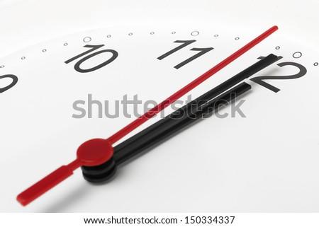 Clock countdown to midnight on white background - stock photo