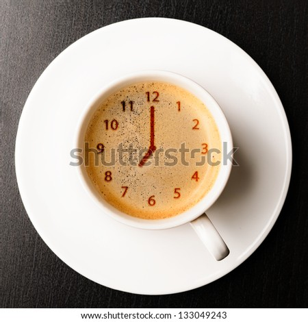 clock. cup of fresh espresso with clock sign, view from above - stock photo