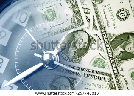 Clock face and American currency - stock photo
