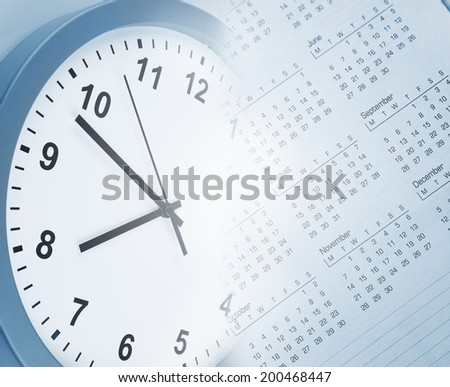 Clock face and calendar page - stock photo