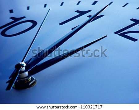 Clock face in blue tone. Time concept. - stock photo