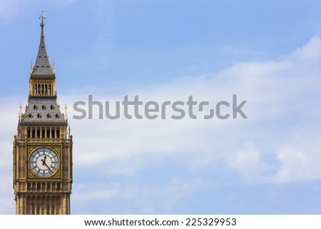 Clock face on the famous landmark clock tower known as Big Ben in London, England. Part of the Palace of Westminster also known as the Houses of Parliament - stock photo