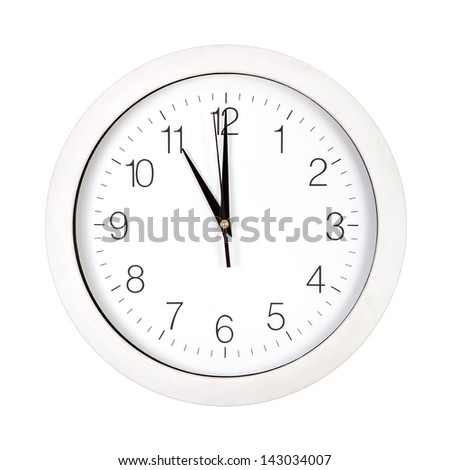 Clock face showing eleven o'clock isolated on white - stock photo