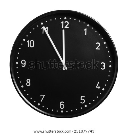 Clock face showing the hands at five minutes to midnight. Isolated on white background - stock photo