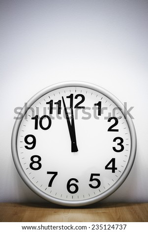 Clock hanging at the wall with copy space.  - stock photo