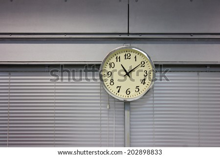 Clock hanging on the wall in office - stock photo