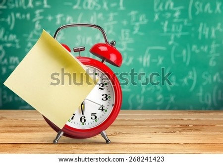 Clock, late, note. - stock photo