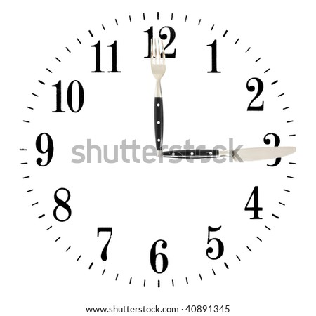 Clock made of knife and fork isolated on white background - stock photo