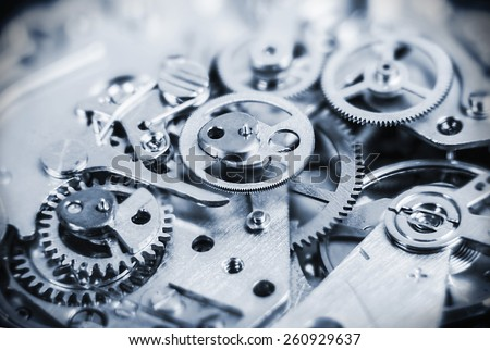 clock mechanism made in the technique of toning. Very shallow depth of field. Focus on the central gears - stock photo