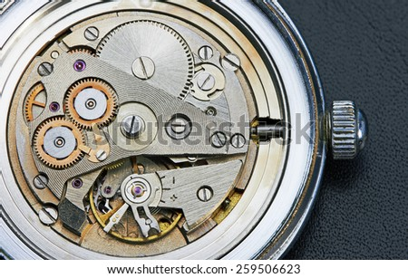 Clock mechanism with gears, close-up. - stock photo