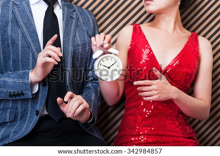 Clock,men and women - stock photo
