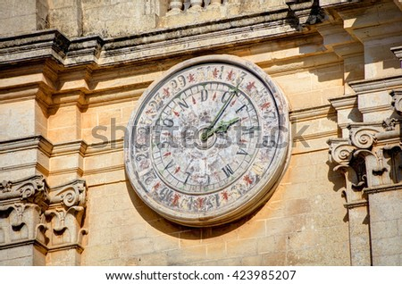 Clock of the St. Peter & Paul Cathedral in the city of Mdina, in Malta - stock photo