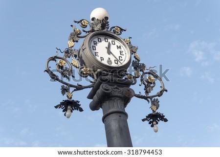 Clock old lamppost on the street, Jerez de la Frontera, Spain - stock photo