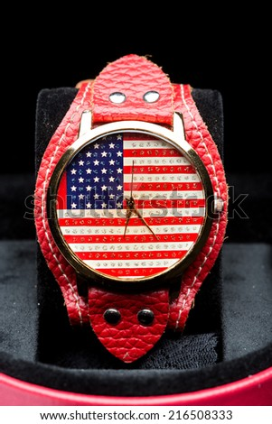 clock on a black background. American Flag - stock photo