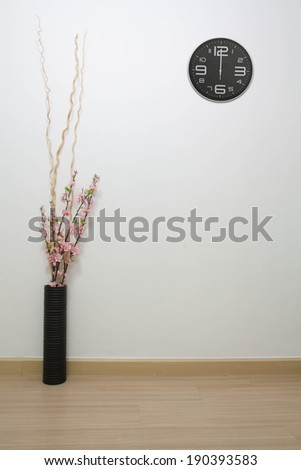 Clock on a white wall background. - stock photo