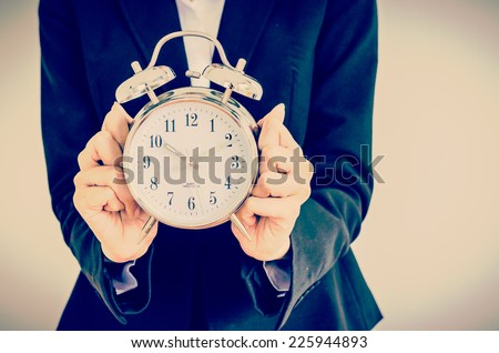 Clock on bussiness hand process vintage instagram effect style picture - stock photo