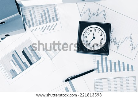 Clock on the market reports  - stock photo