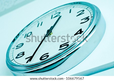 clock on wall show 12.35 for lunch time - stock photo