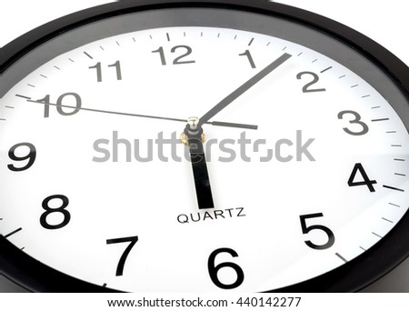 Clock or time abstract background, white clock and black needles, six o'clock, seven minutes - stock photo