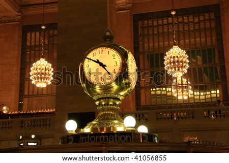 Clock over the information booth in the middle of the great hall in Grand Central Terminal - New York - stock photo