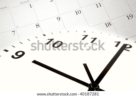 Clock pointing to nine o'clock and calendar. - stock photo