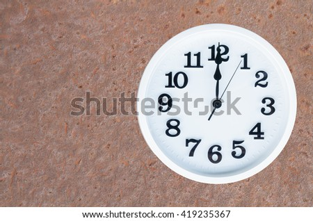 Clock show 12 am or pm on steel rusty background with copy space. clipping path in picture. - stock photo