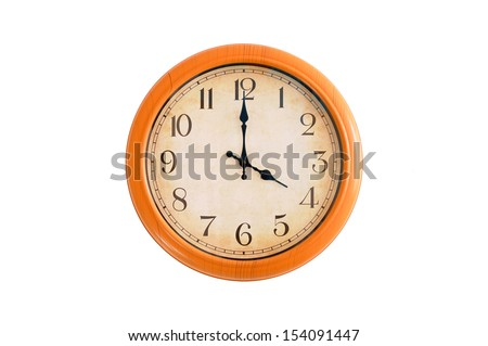 Clock showing 4 O'clock on a white wall  - stock photo