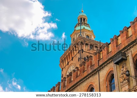Clock Tower and facade of the Palazzo Comunale in Bologna. Italy - stock photo