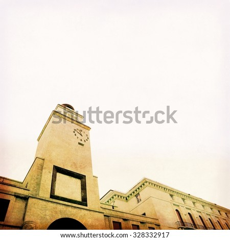 Clock tower in Brescia, Italy. Italian architecture of the 30s. - stock photo