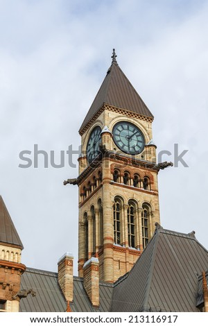 Clock tower in the Old City Hall in Toronto a site that is heritage of the city and an important tourist landmark - stock photo