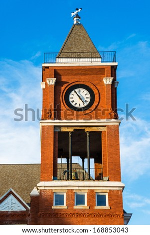 Clock tower of historic small town court house building in Dallas, GA - stock photo