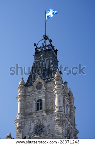 Clock tower of the Quebec parliament building (Hôtel du Parlement) in winter Quebec city. - stock photo