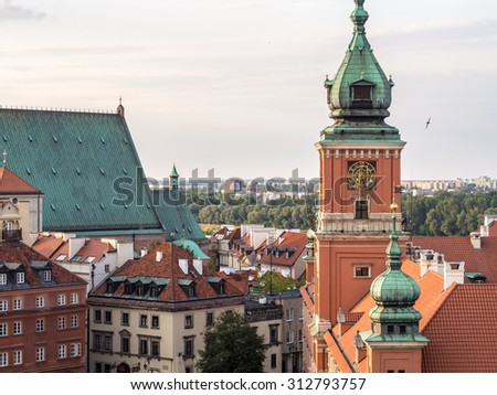 Clock tower of the Royal Castle in the Old Town of Warsaw, Poland. - stock photo