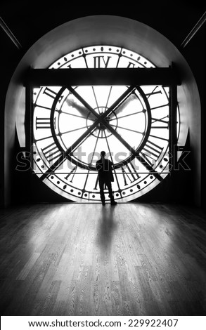 clock with a silhouette of a man, b&w image - stock photo
