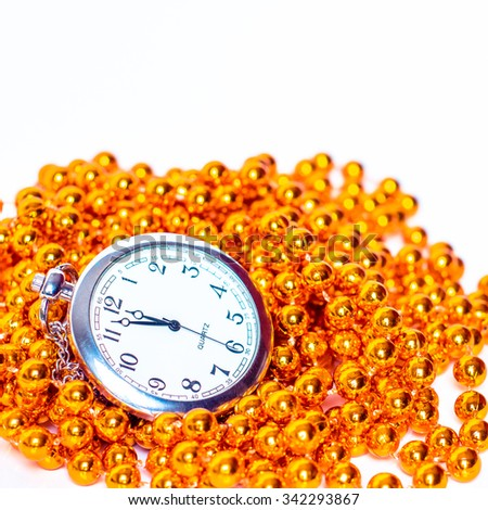 Clock with gold beads. New year celebration time. Eve of midnight hour. December holiday. Old vintage watch. Number countdown. Celebrate festive background. Twelve hours. Happy minute. - stock photo