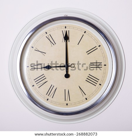 clock with Roman numerals at 9 o'clock - stock photo