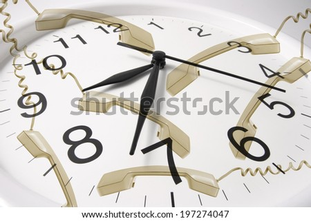 Clock with Telephone Receivers - stock photo