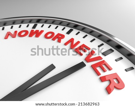 Clock with words now or never on its face - stock photo