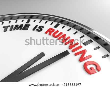 Clock with words time is running on its face - stock photo