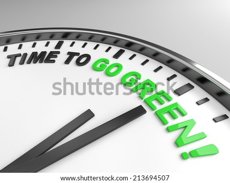 Clock with words time to go green on its face - stock photo