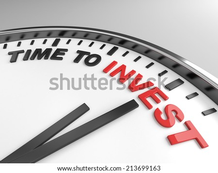 Clock with words time to invest on its face - stock photo